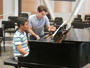 Music Director, Dr. David Rentz working with youth soloist, Aldric Gozon, to prepare for the September 25, 2016 concert.